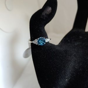 Silvertone Subtle Flower Ring with Blue Stone